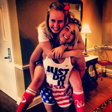 Carly and Audrey look so happy showing off their Alpha Chi O'merica gear!